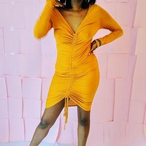 Yellow/gold bodycon dress